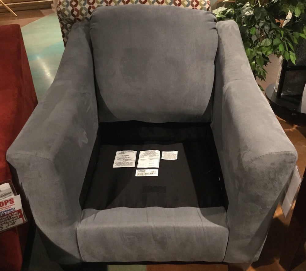 Chair with cushion removed to show cleaning code labels