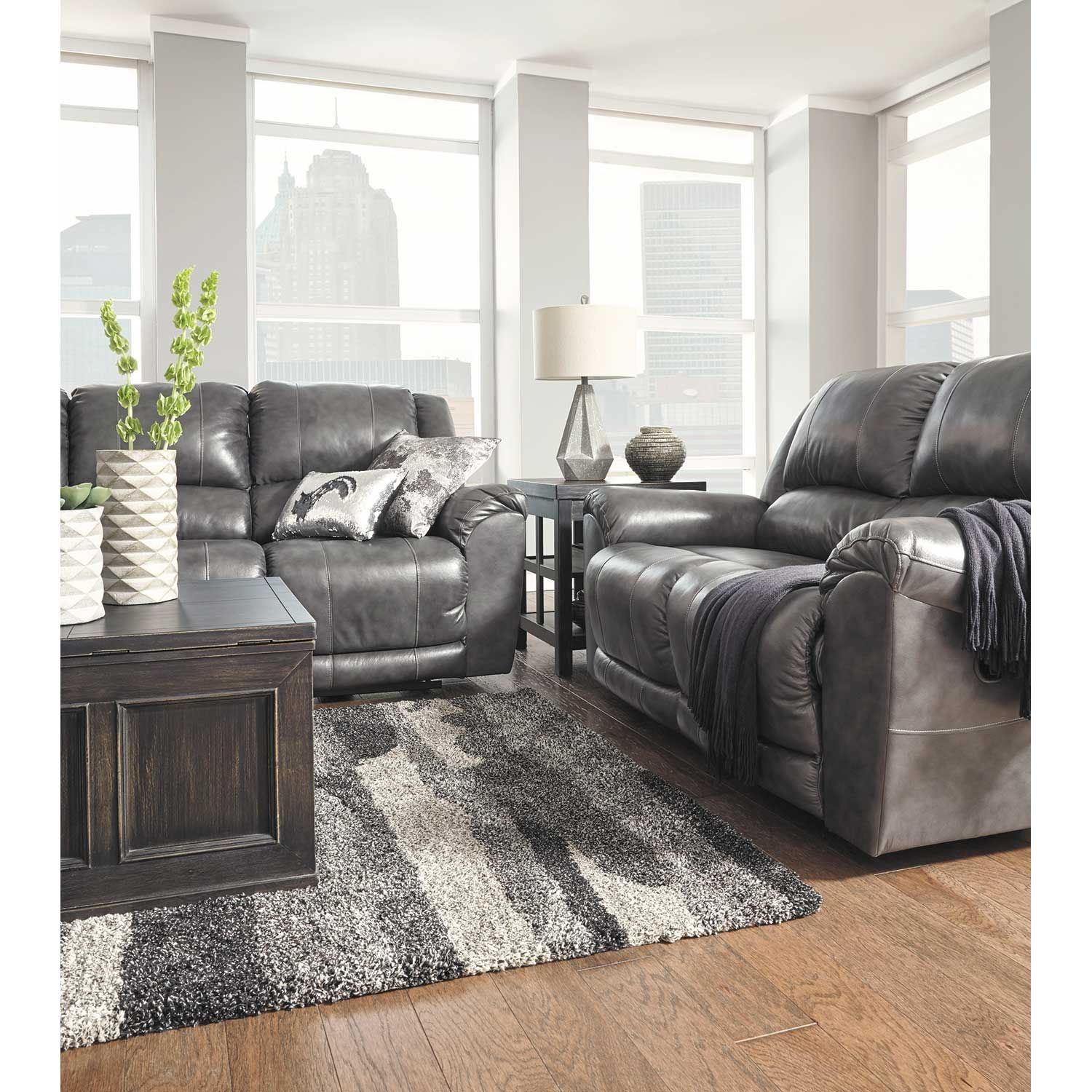 Ashley Furniture Manufacturers: Persiphone Charcoal Leather Reclining Sofa