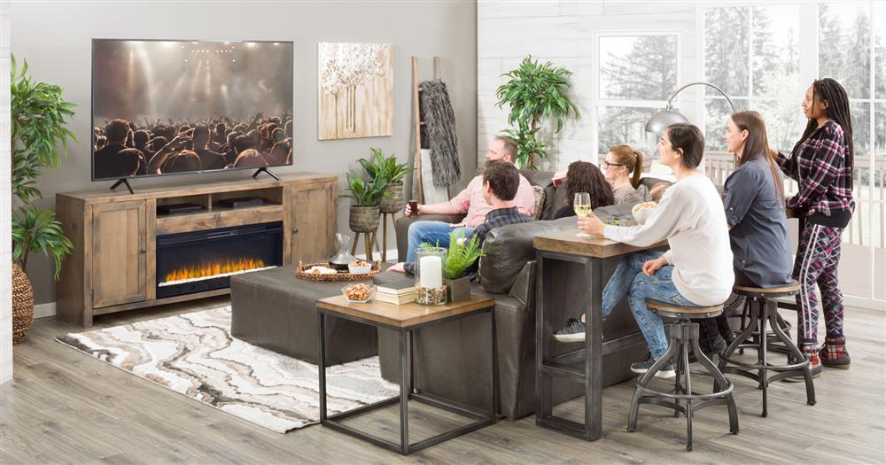 People in living room sitting at a sofa bar table